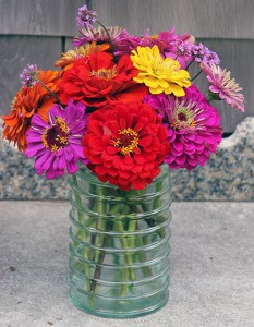 Being unexpectedly handed a colorful bouquet of zinnias will make anyone smile.